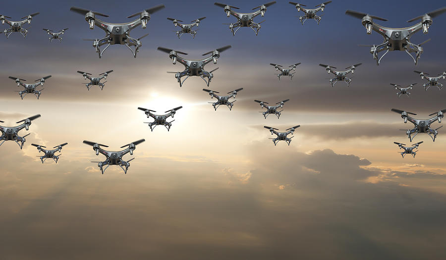 Flock Of Drones In The Sky At Sunset Photograph by Buena Vista Images
