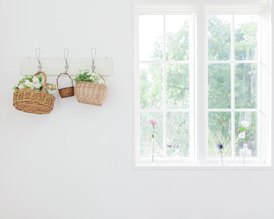 Flowers In Baskets On Wall Photograph by Bloom Image