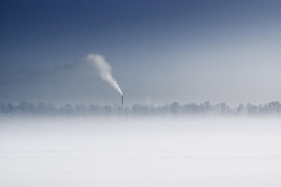 Fog Over  Frozen River With Fuming Pipe Photograph by Dmitry Savin