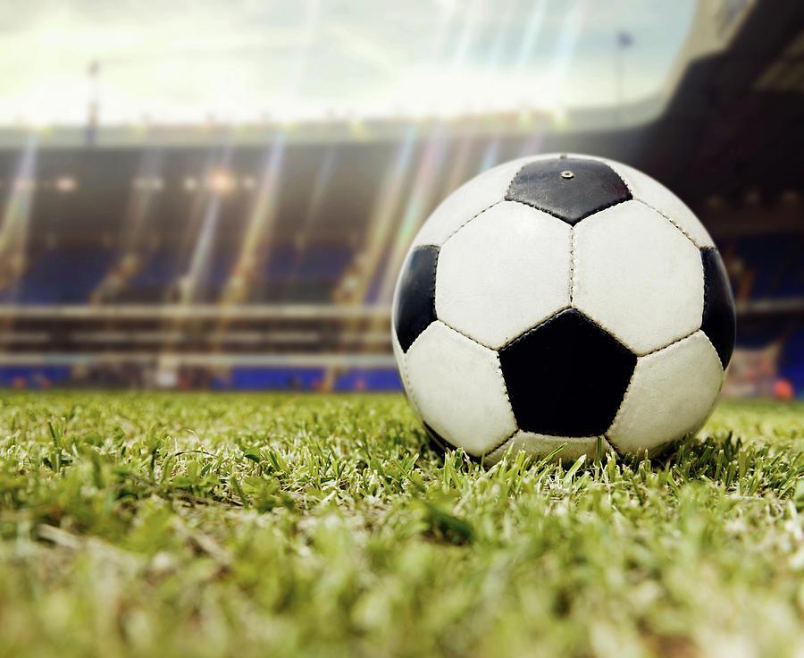 Football Ball At The Stadium Photograph by Andresr