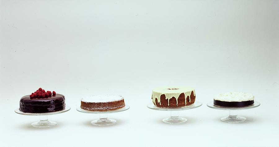 Four Cakes Side By Side Photograph by Romulo Yanes