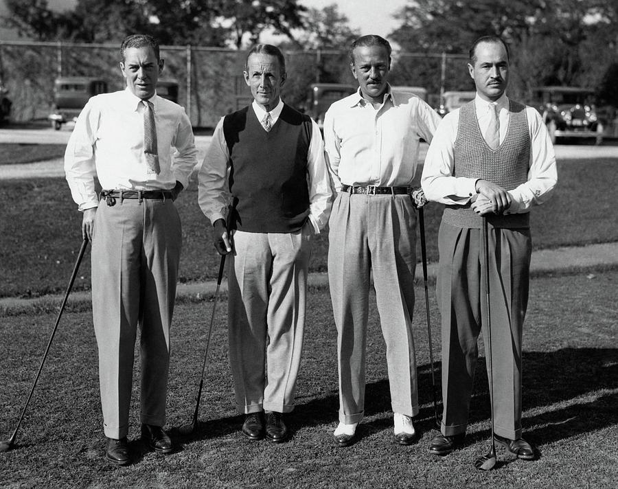 Four Men On A Golf Course Photograph by Artist Unknown