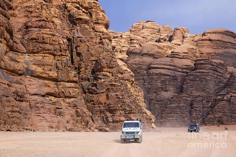 Jordan Photograph - Four Wheel Drive Vehicles At Wadi Rum Jordan by Robert Preston
