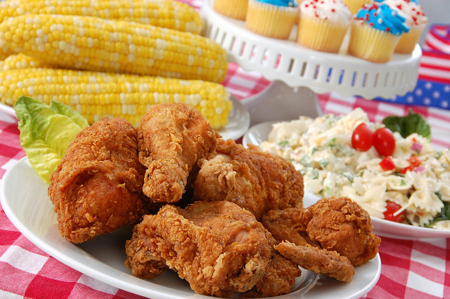 Fourth Of July Picnic With Chicken, Corn And Cupcakes Photograph by Sbossert