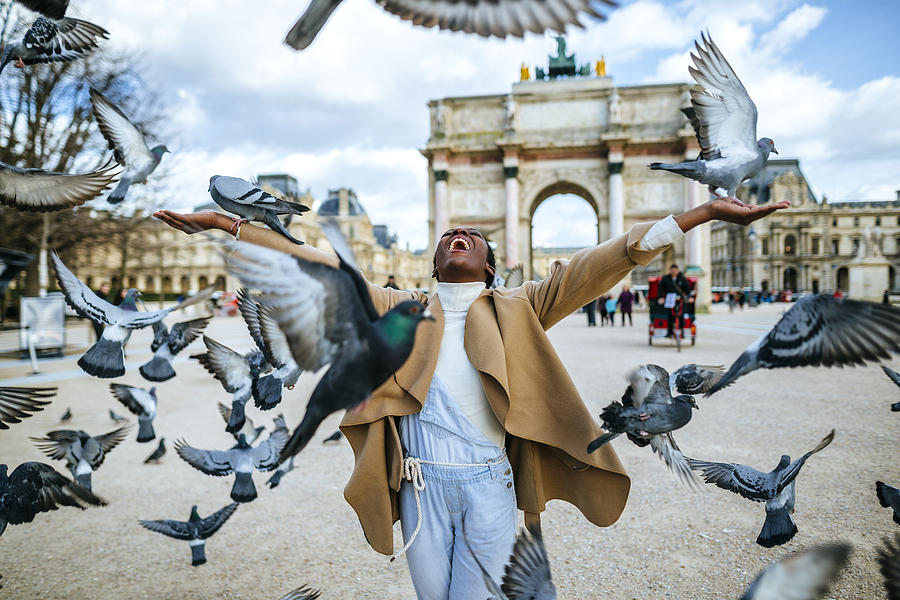 France, Paris, Happy Young Woman With Flying Pidgeons At Arc De Triomphe Photograph by Westend61