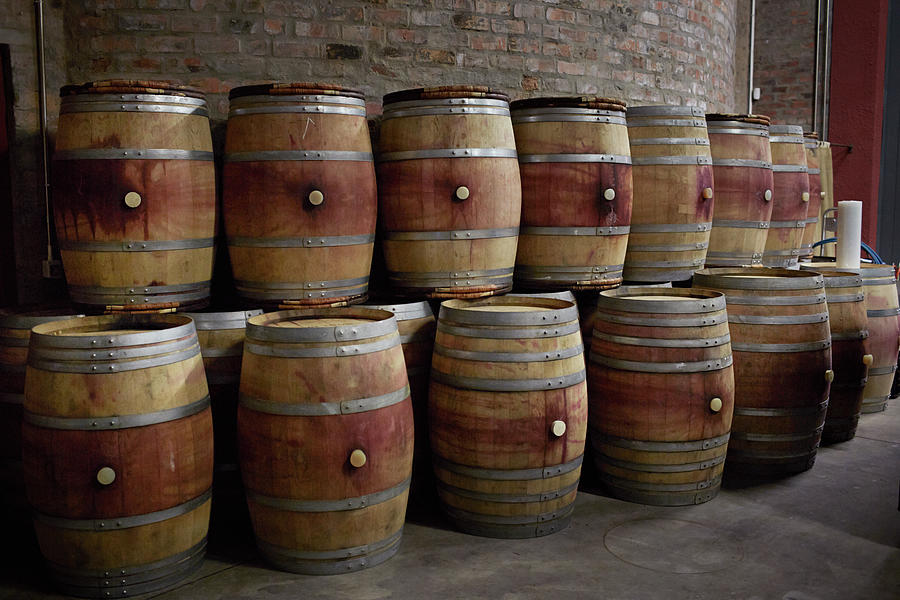 French Wine Barrels Stacked At Winery Photograph by Klaus Vedfelt