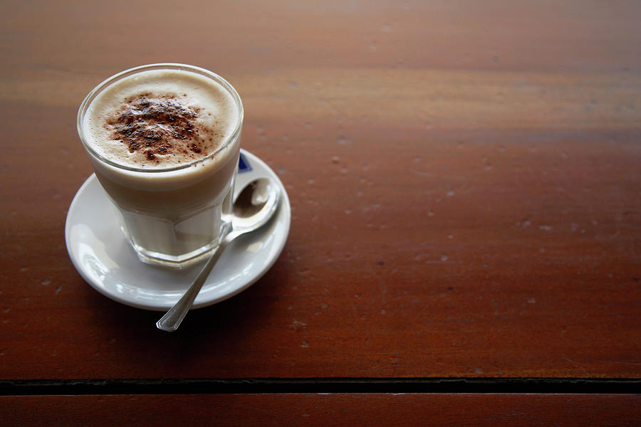 Fresh Latte Coffee On A Rustic Cafe Photograph by Andrew Bret Wallis