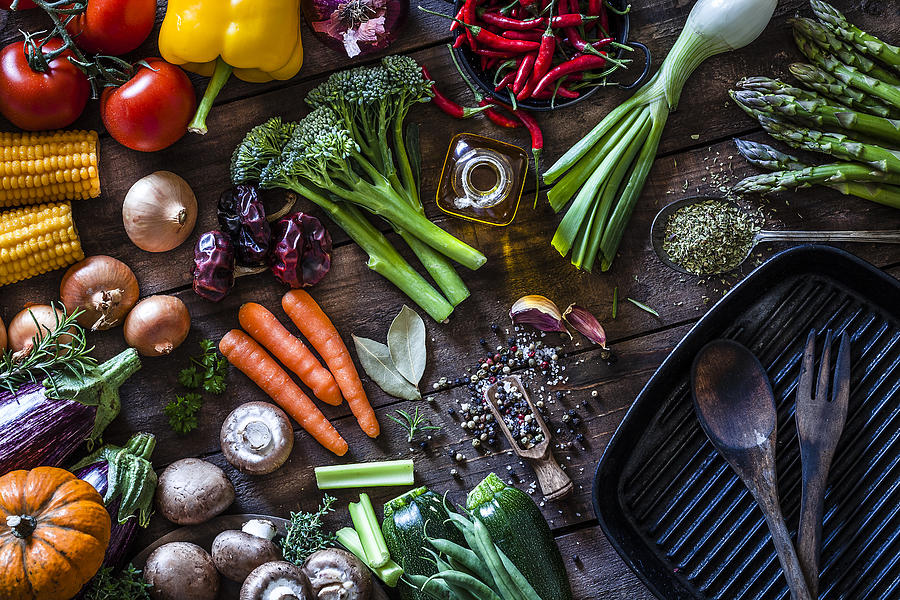Fresh vegetables ready for cooking shot on rustic wooden table Photograph by Fcafotodigital
