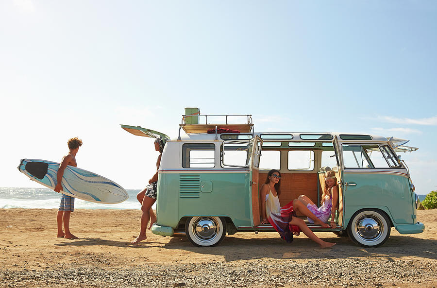 Friends With Van Relaxing On Beach Photograph by Colin Anderson Productions Pty Ltd