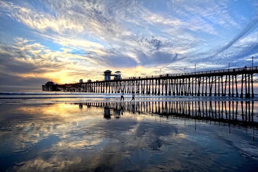 Oceanside Photograph - Frolicking by Julianne Bradford