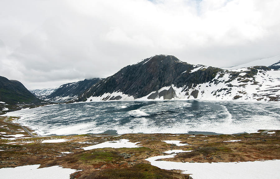 Frozen Lake - Dalsnibba Mountains Photograph by Thierry Dosogne