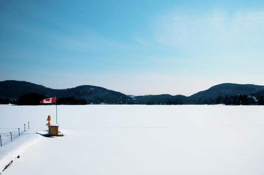 Frozen Lake In Canada Photograph by Haja Rasambainarivo