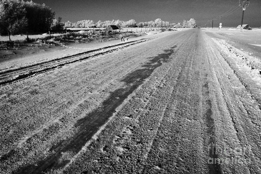 Salt Photograph - frozen salt and grit covered rural small road in Forget Saskatchewan Canada by Joe Fox