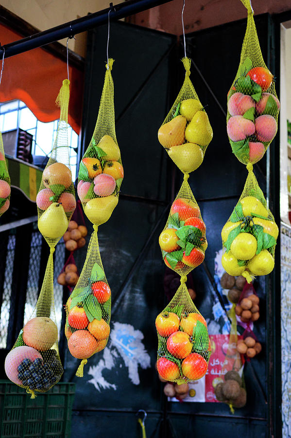 Fruits Hanging From A Market Stall Photograph by Paolo Negri