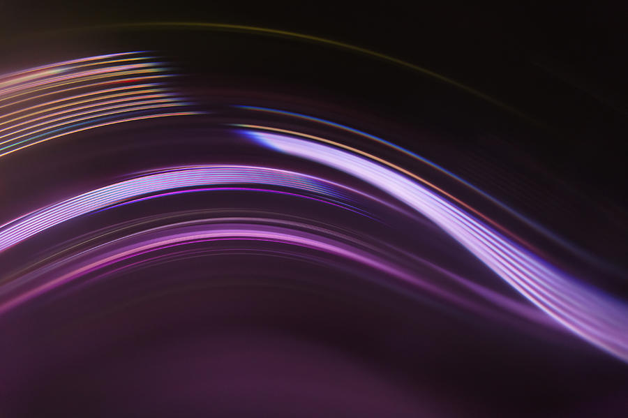 Full Frame Abstract Image Of Purple Light Trails Against Black Background Photograph by Ralf Hiemisch