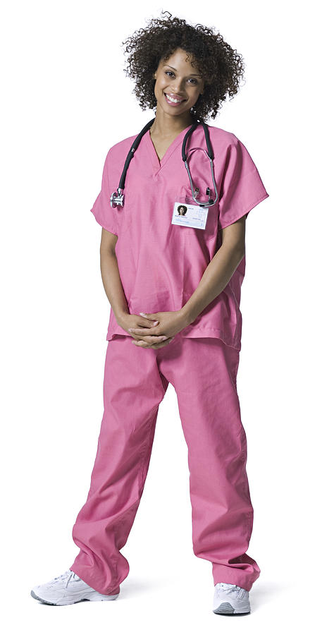 Full Length Portrait Of A Young Adult Female Nurse In Pink Scrubs As She Smiles Photograph by Photodisc