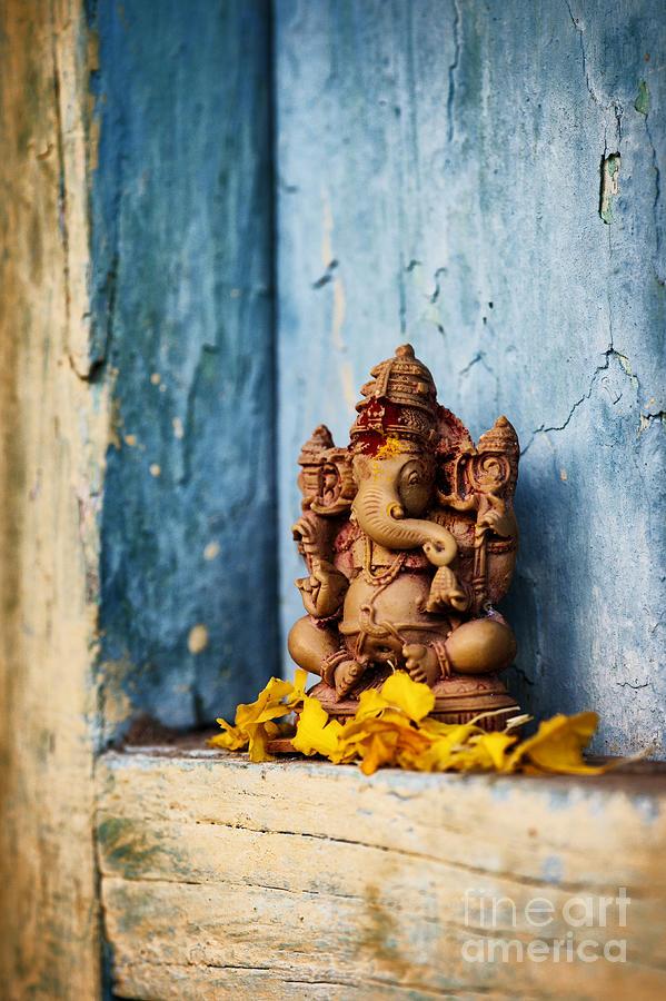 Ganesha Photograph - Ganesha Statue And Flower Petals by Tim Gainey