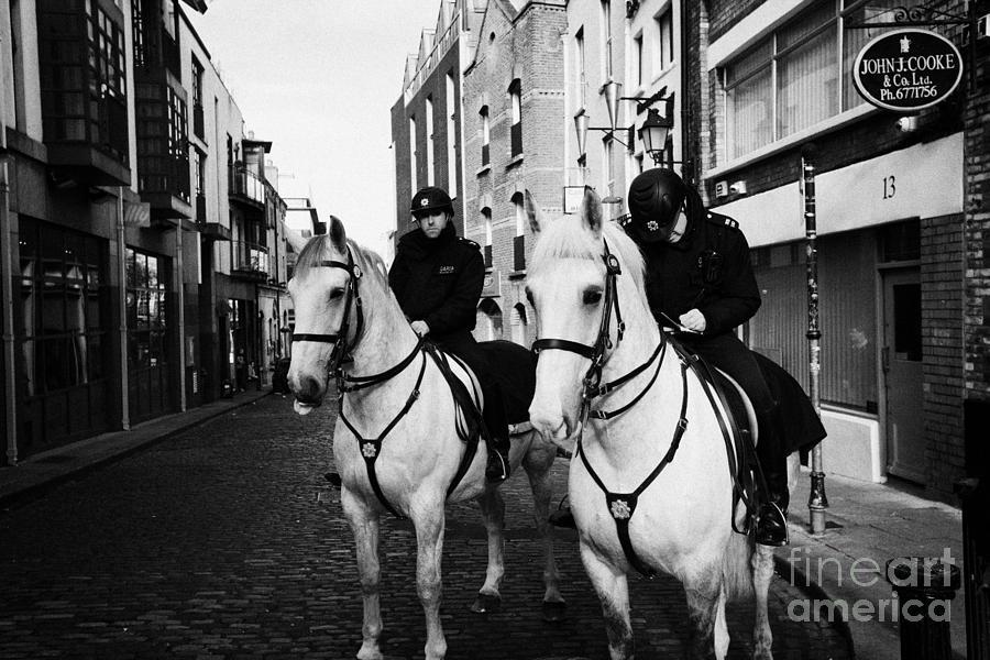 Garda Photograph - Garda Siochana Mounted Police On Horseback Taking Notes In Temple Bar Dublin Republic Of Ireland by Joe Fox