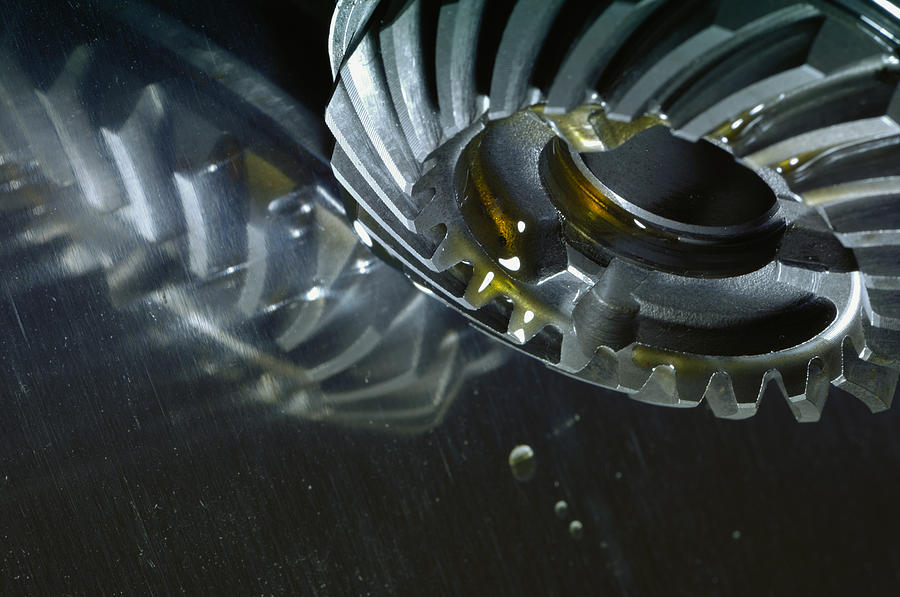Oil Photograph - Gears Cogs And Oil Industry by Christian Lagereek