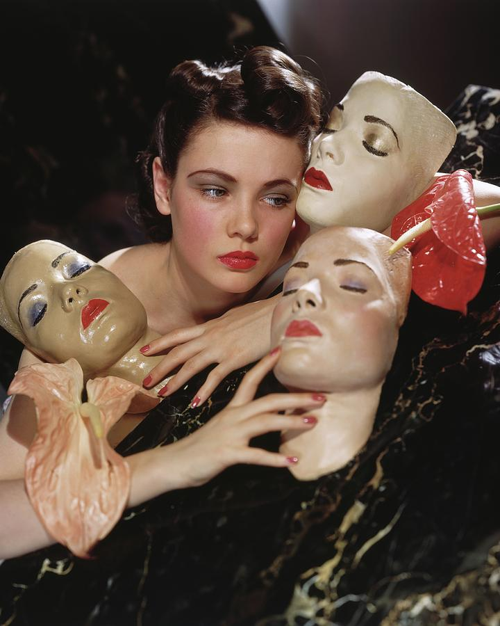 Gene Tierney With Portrait Masks Photograph by Horst P. Horst