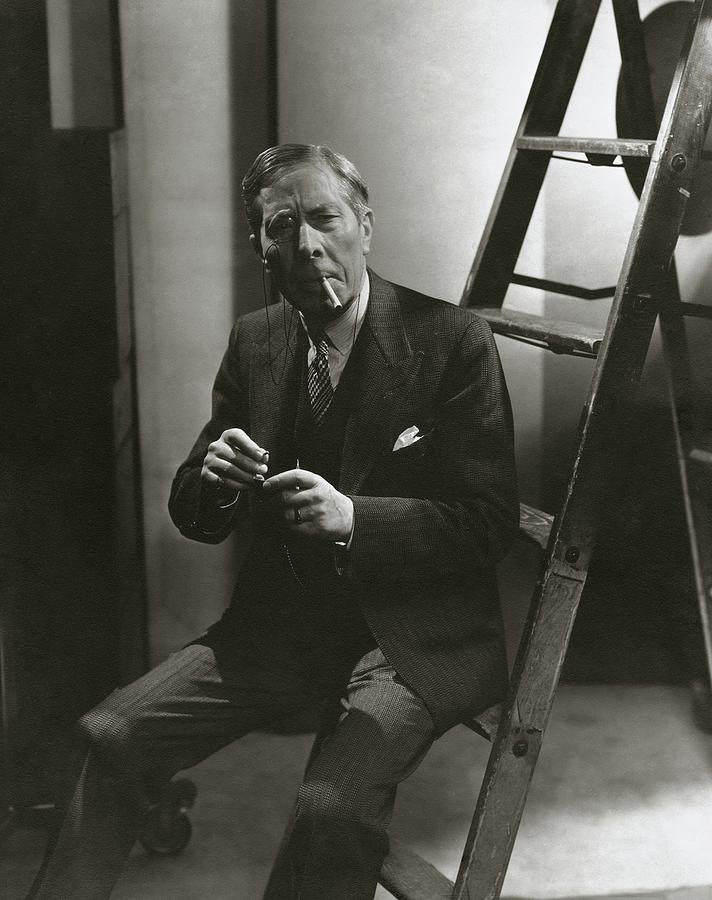 George Arliss Sitting On A Ladder Photograph by Lusha Nelson