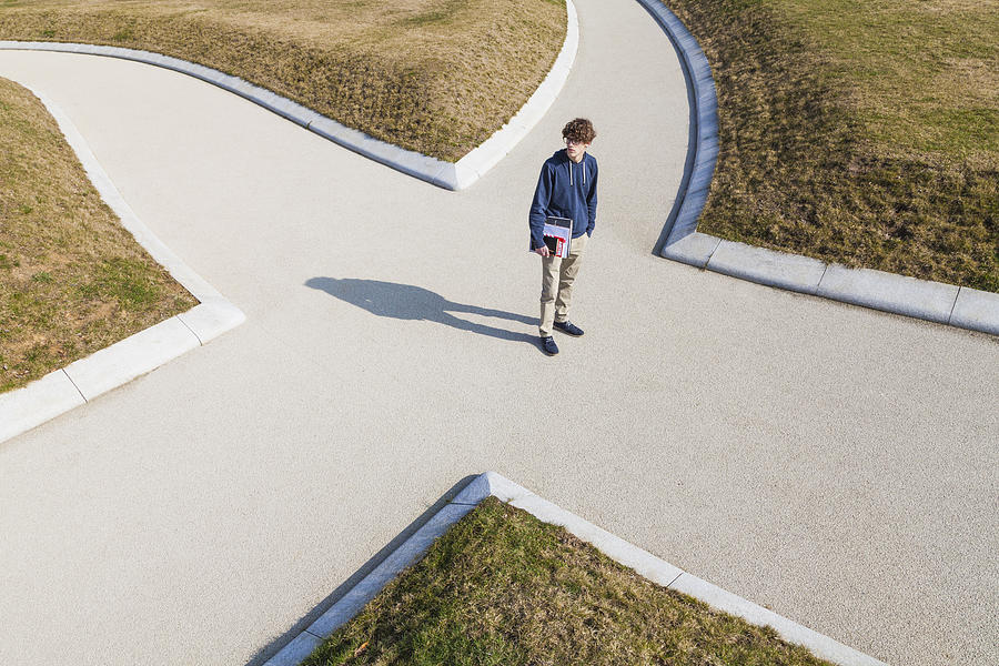 Germany, Baden-Wurttemberg, Teenage boy standing at crossing Photograph by Westend61