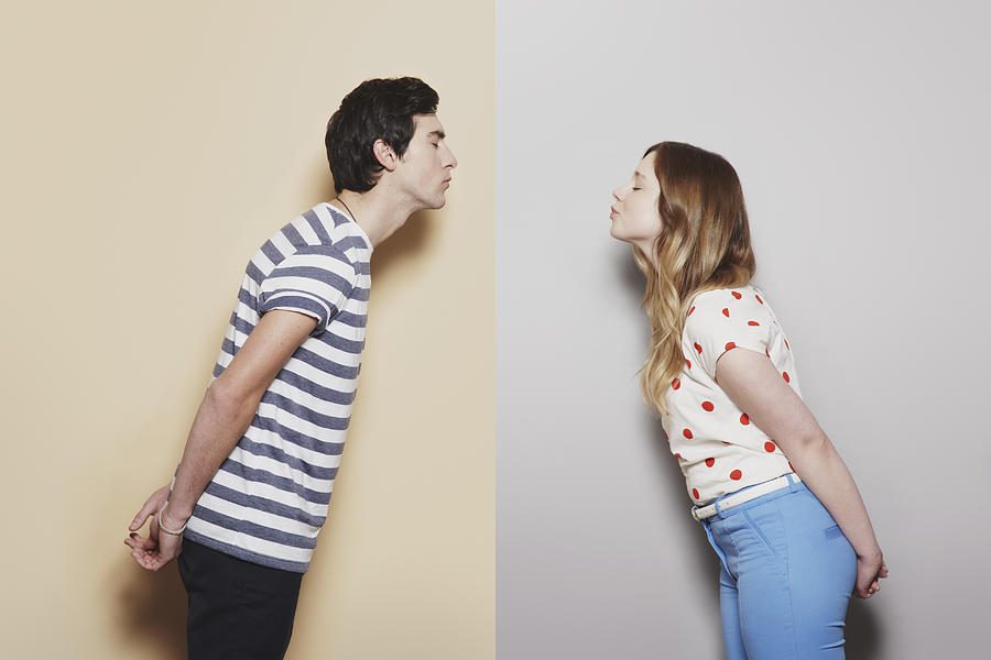 Girl and boy about to kiss Photograph by David Ryle
