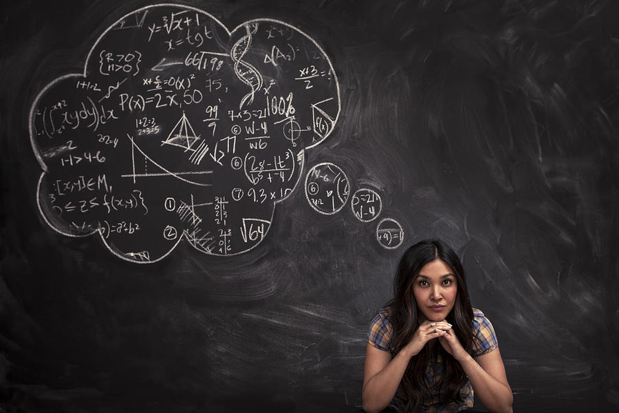Girl contemplates math thought bubble on chalkboar Photograph by Justin Lewis