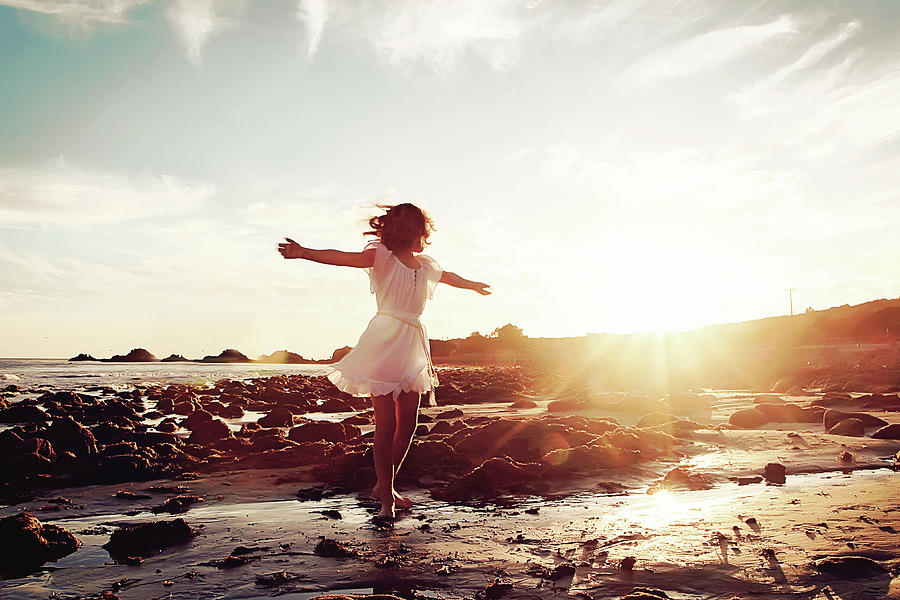 Girl Dancing On Beach At Sunset Sun Rays Photograph by Dianne Avery Photography