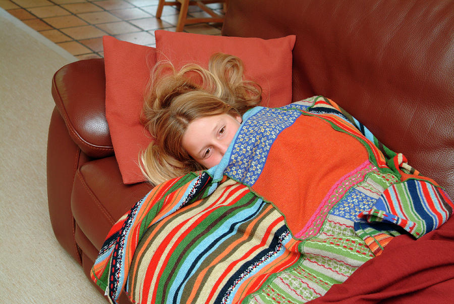 Blanket Photograph - Girl Feeling Unwell by Cc Studio/science Photo Library