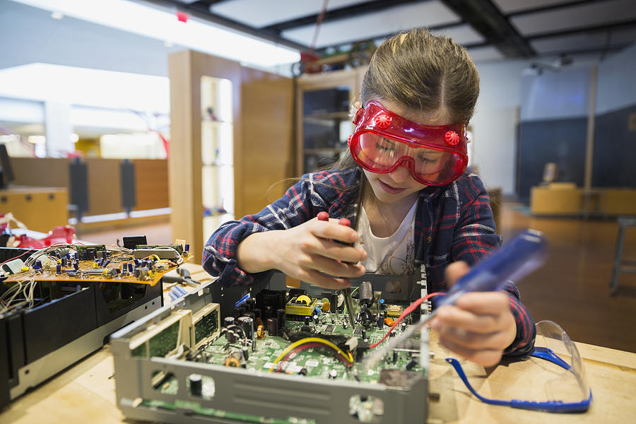 Girl Goggles Assembling Electronics Circuit At Science Center Photograph by Hero Images
