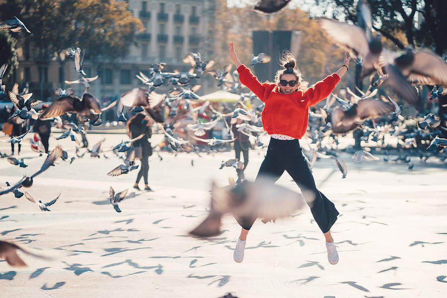 Girl jumping from joy in Barcelona Photograph by Martin-dm
