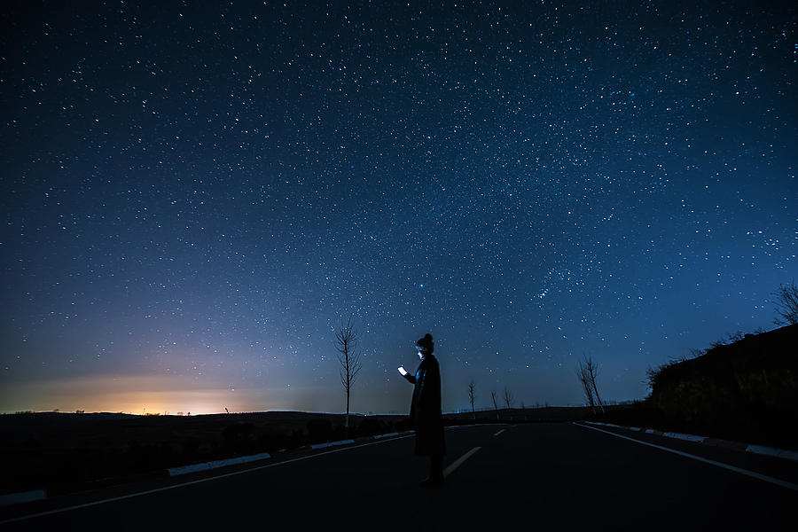 Girl Using A Mobile Phone in Starry night Photograph by Dong Wenjie