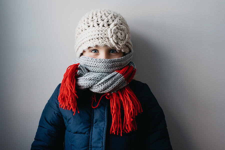 Girl warmly wrapped up in woollen hat and scarf Photograph by Hugh Whitaker