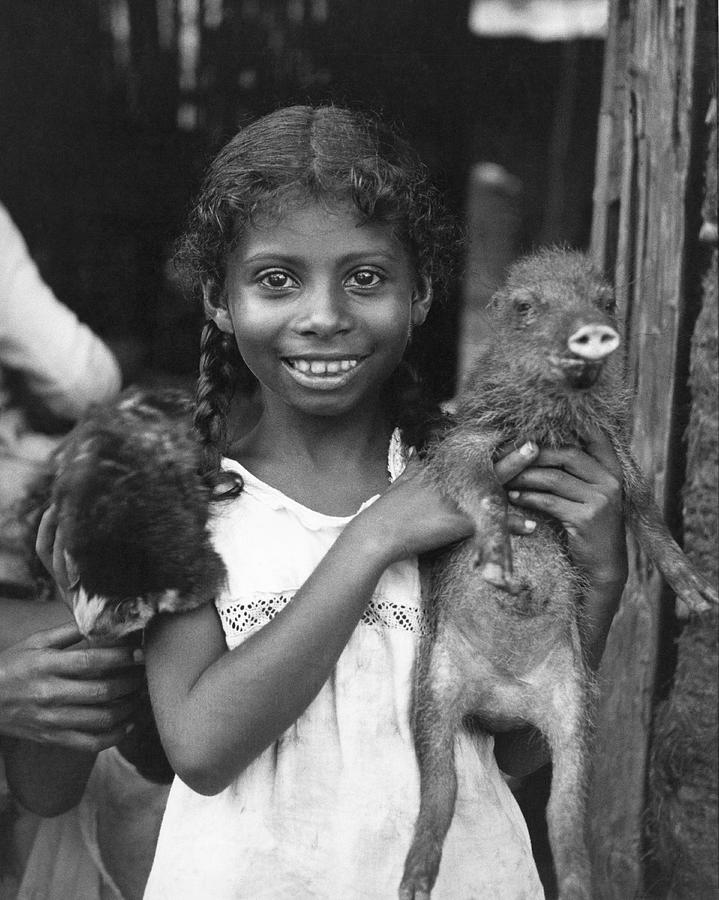 1935 Photograph - Girl With Pet Peccary by Underwood Archives
