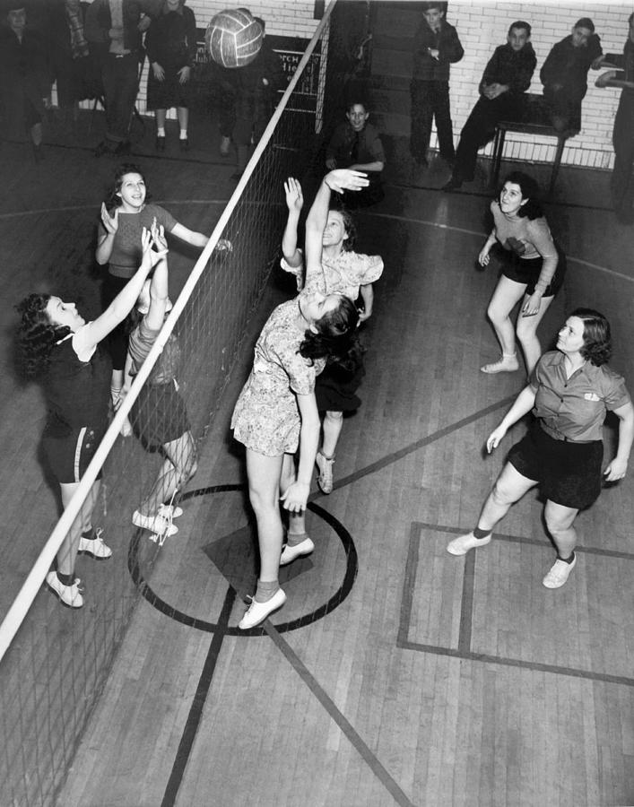 1949 Photograph - Girls Playing Volleyball by Underwood Archives