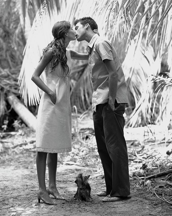 Gisele Bundchen Kissing A Young Man Photograph by Arthur Elgort