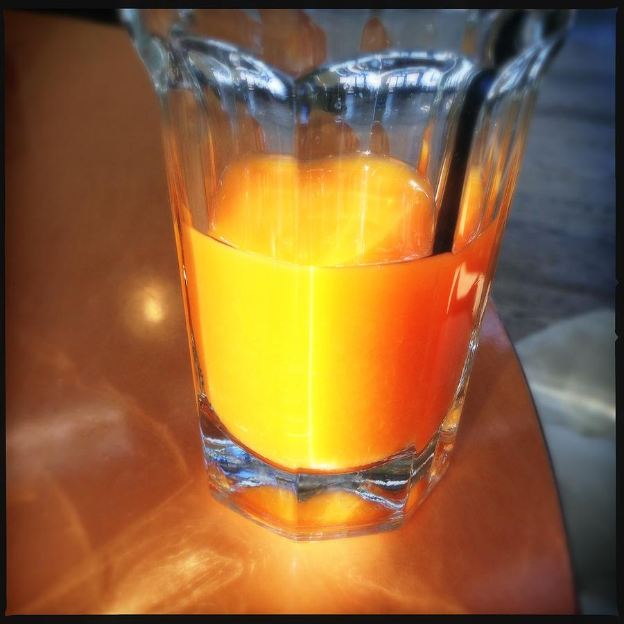 Orange Juice Photograph - Glass With Orange Fruit Juice by Matthias Hauser