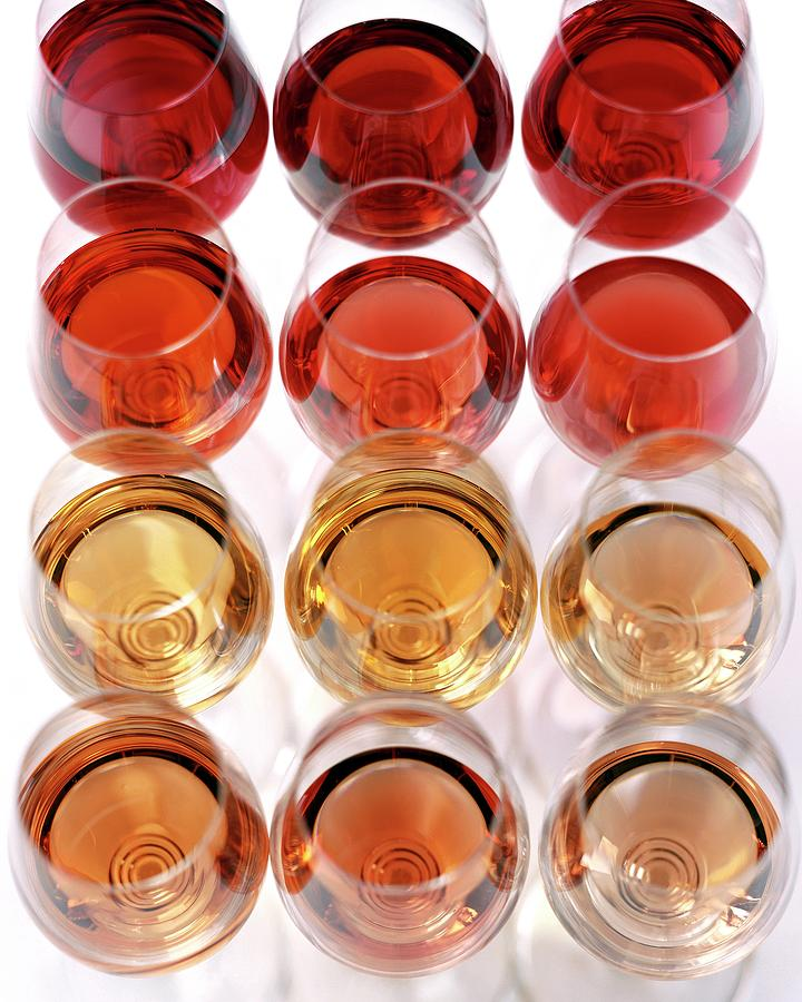 Glasses Of Rose Wine Photograph by Romulo Yanes