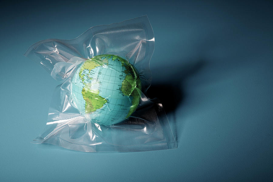 Globe Shrink Wrapped In Plastic Photograph by Henrik Weis