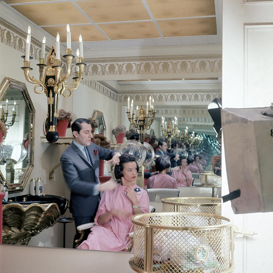 Gloria Vanderbilt At The Revlon Boutique Photograph by Horst P. Horst