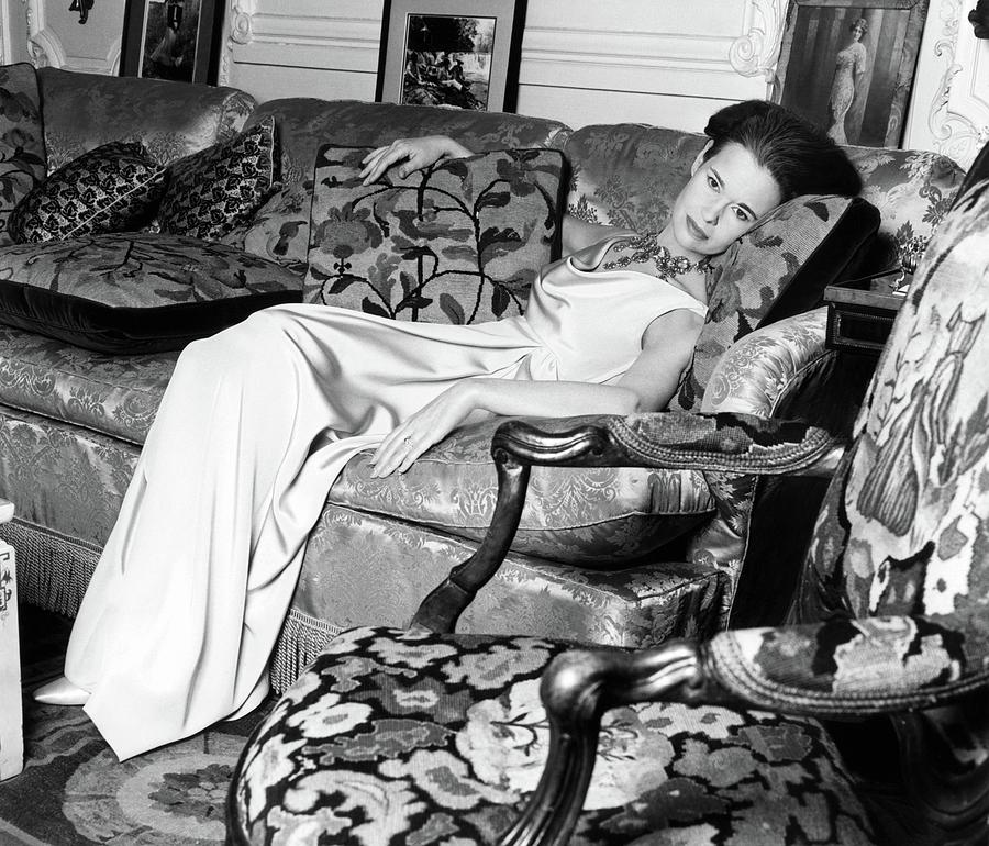 Gloria Vanderbilt Reclining On A Couch Photograph by Horst P. Horst