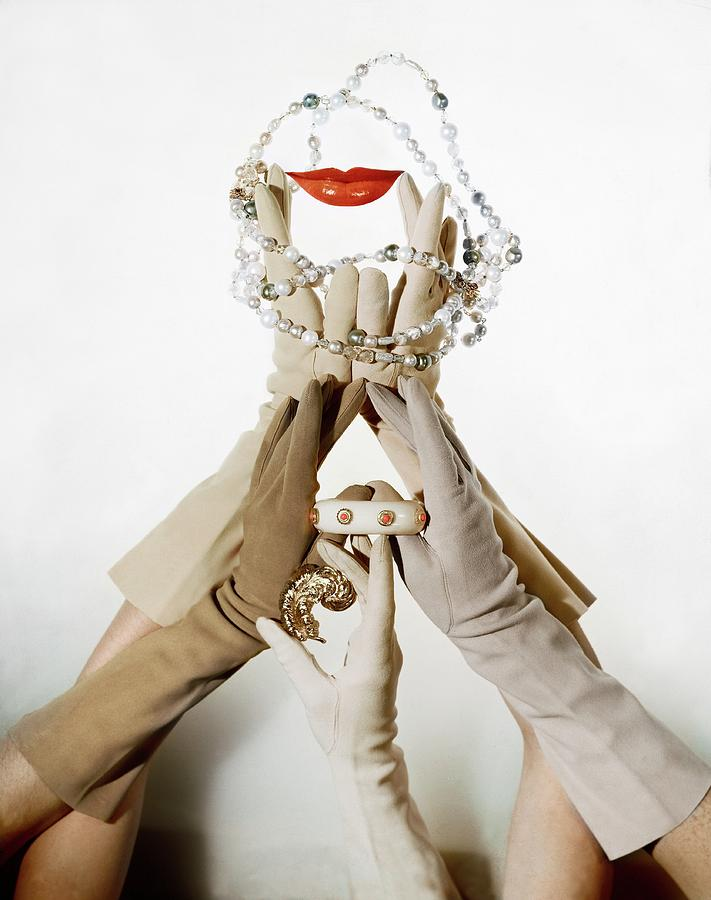 Gloved Hands Holding Jewelry Photograph by John Rawlings