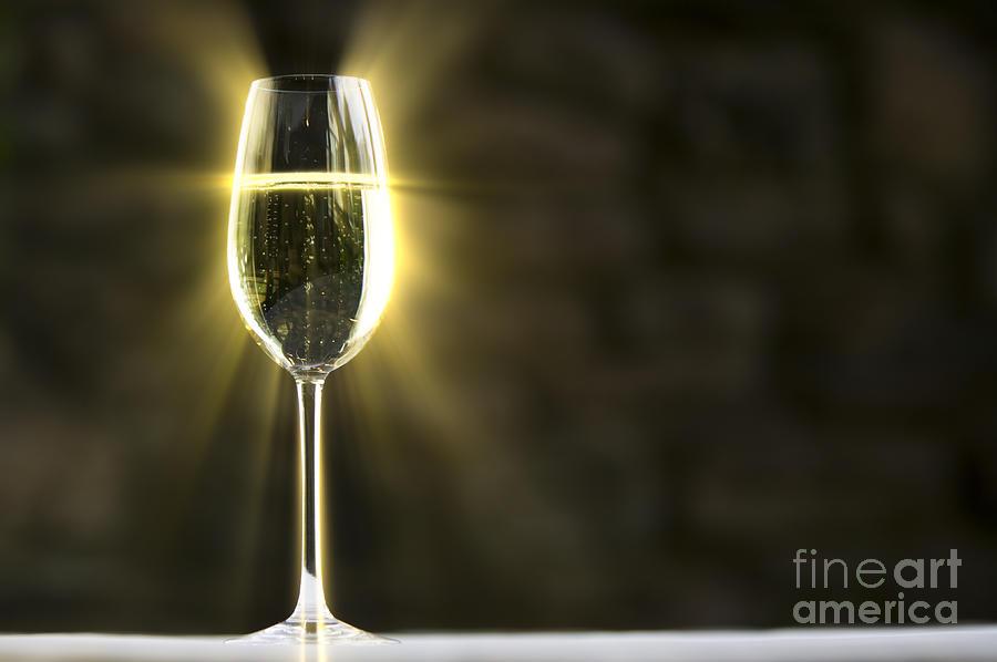 Glowing Champagne Glass Photograph