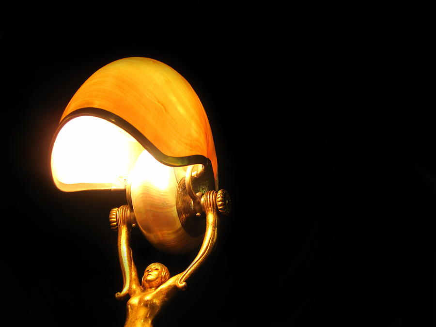 Light Photograph - Glowing Shell by Jhoy E Meade