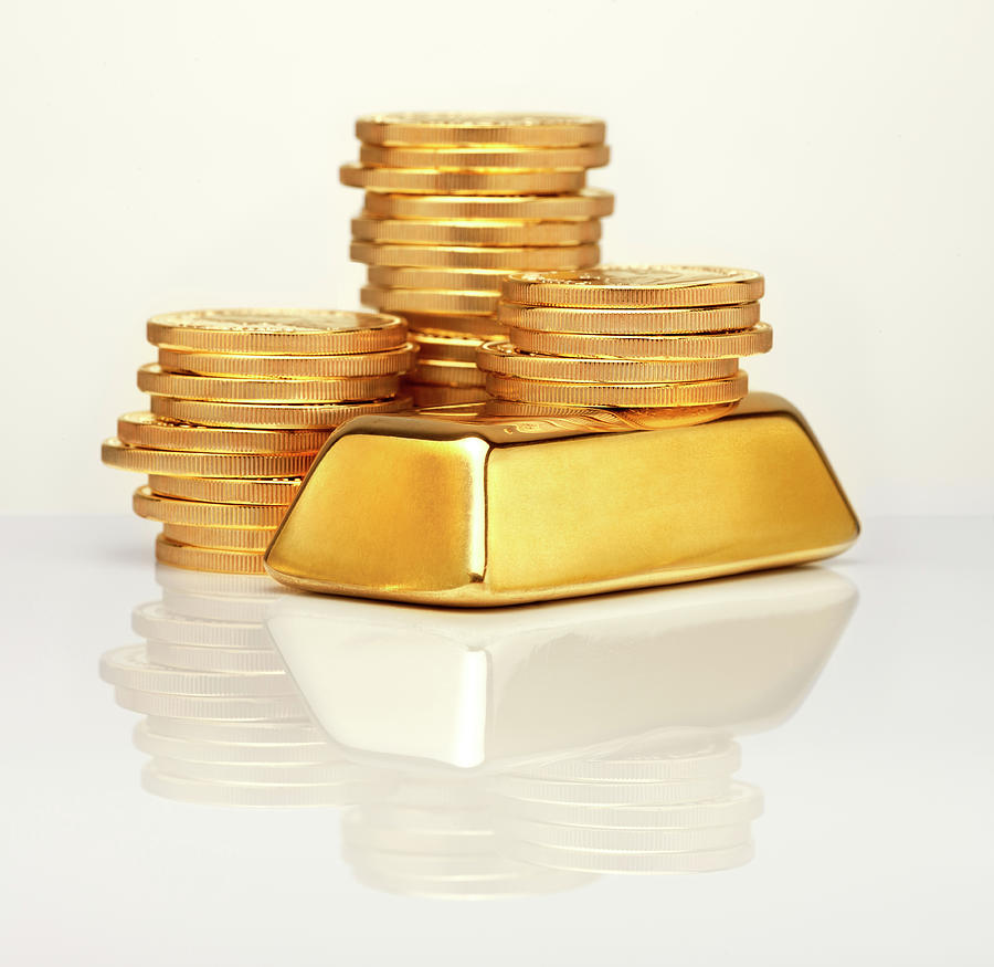 Gold Ingot In Front Of Gold Coins Photograph by Anthony Bradshaw