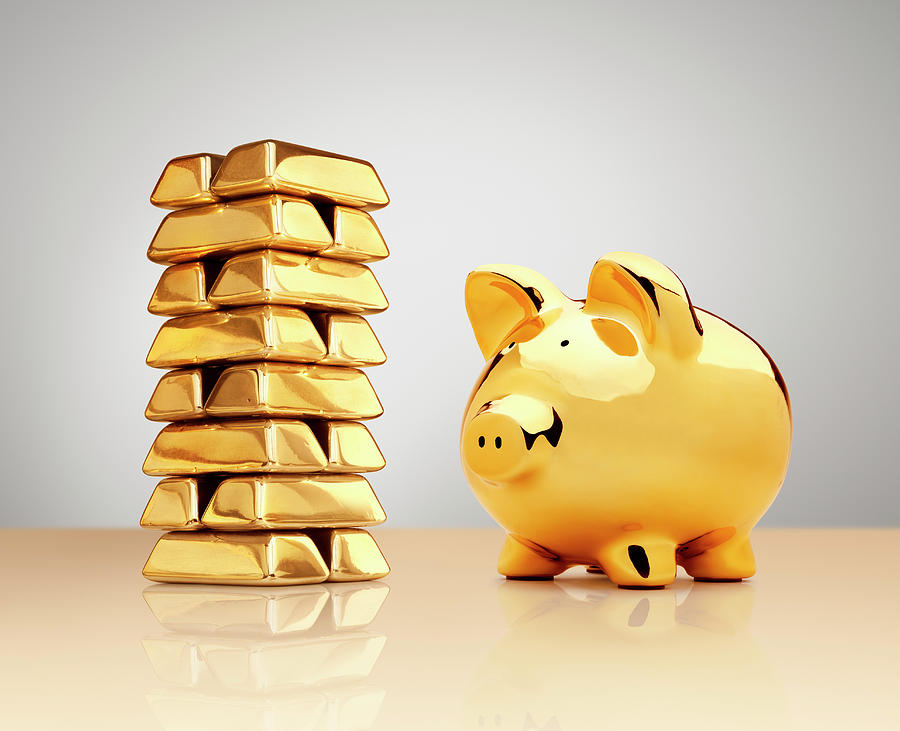 Gold Piggy Bank Beside A Stack Of Ingots Photograph by Anthony Bradshaw