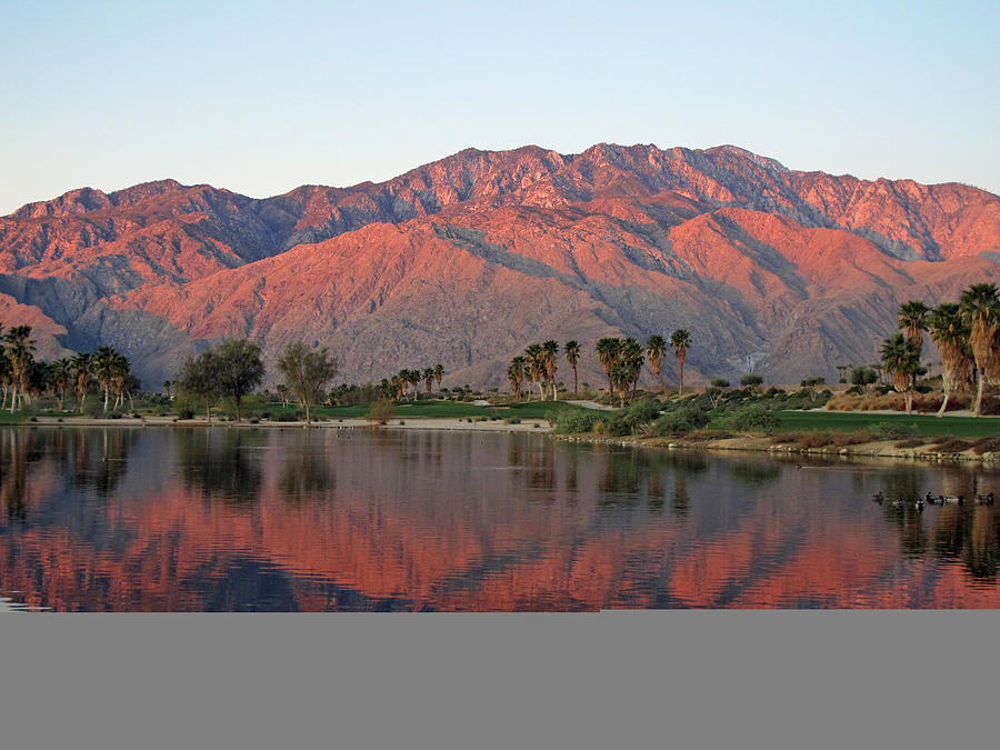 Golf course at dawn with sunrise kissed mountains Photograph by Wildroze