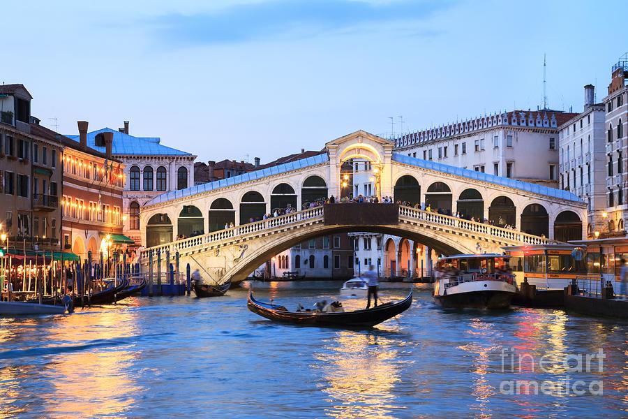 Venice Photograph - Gondola In Front Of Rialto Bridge At Dusk Venice Italy by Matteo Colombo