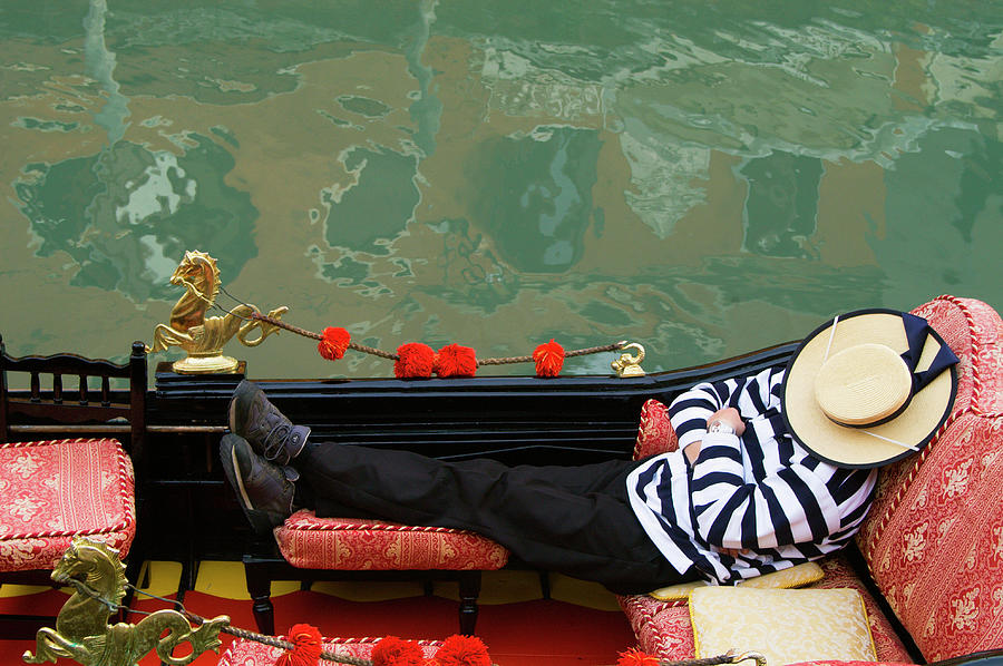 Gondolier Resting In Gondola Photograph by Brent Winebrenner